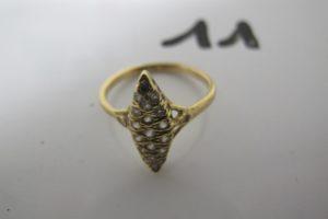 1 Bague Marquise en or rehaussée de pierres blanches dont 1 manquante(td 55)PB 2,8g