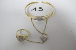 1 Bracelet de main 2 ors ouvrant et sa bague à décor de coeurs,ornés de pierresblanches (D6cm)(TD57).PB 13,8g