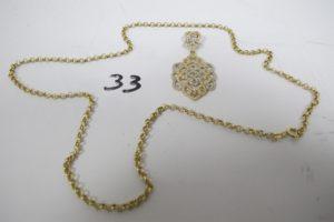 1 Collier en or maille jazeron (L53cm),1pendentif 2 ors ajouré orné de petites pierres blanches(H5cm). PB 8,3g