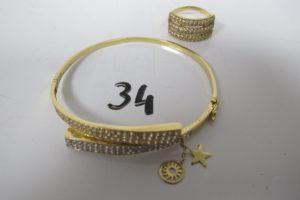 1 Bracelet 2 ors ouvrant pavé de petitespierres blanches (7 manquantes) avec 2 pampilles (D6cm), 1 bague en or 3 rangs pavés de petites pierres blanches(td 58)PB 14,6g