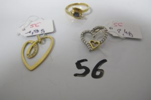 1 Bague en or rehaussée d'une pierre bleue entourée de 2 pierres blanches (TD54),2 pendentifs en or à motif de coeur pavé de petits diamants.PB 6,9g