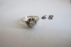 1 Bague solitaire en or gris rehaussé d'un diamant de 0,20 ct env(td54) corps brisé.PB 4,1 g
