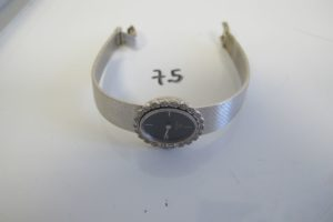 """1 Montre de dame en or gris de marque """"Omega"""" HS entourage de petits diamants(D 6cm).PB 38,7g"""