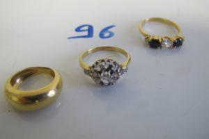 3 Bagues en or(1 modèle ancien rehausséede 10 petits diamants taille ancienne(td59)/1 anneau (td42)/1 rehaussée de 2 pierres bleues et d'une pierre blanche entourées de 2 petits diamants(td53). PB 9,9g