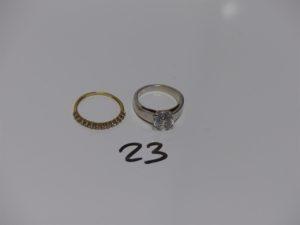 2 bagues en or : 1 ornée d'1 pierre blanche (Td50) et 1 ornée de petites pierres (Td52). PB 6,8grs