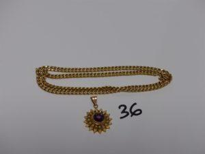1 chaîne maille gourmette (L48cm) et 1 pendentif soleil orné d'une pierre violette. Le tout en or PB 8,9g