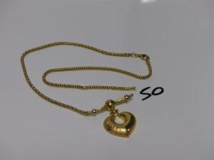 1 collier maille serpent en or motif central à décor d'un coeur (chaîne cassée, L42cm). PB 14,1g