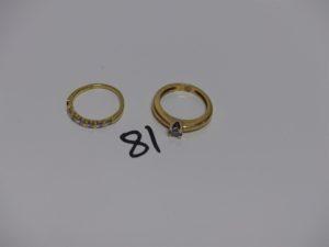 2 bagues en or: 1 rehaussée d'un petit diamant (td51) et 1 ornée de 6 petits diamants (td50, 1 chaton vide). PB 6,5g