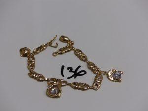1 bracelet gourmette en or ornée de 4 breloques dont 2 avec 1 pierre (L17cm, creux). PB 5,9g