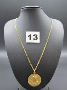 1 chaîne maille gourmette (L 60cm), 1 médaille 2 faces (st Vierge et Christ). Le tout en or. PB 15,7g
