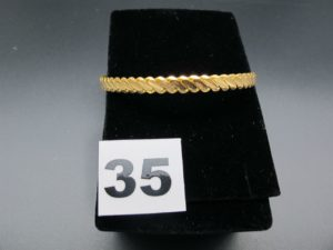 1 bracelet rigide tressé en or 22K (diamètre 6,5cm). PB 20,3g
