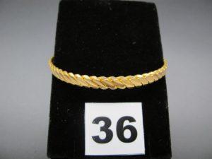 1 bracelet rigide tresé en or 22 K (diamètre 6,2cm). PB 20g