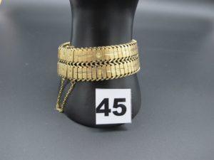 1 bracelet en or maille articulée avec chaîne de sécurité (manque poussoir sur fermoir L 19cm). PB 53,7g