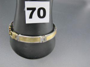 1 bracelet homme en or bicolore rhodié, maille articulée avec son fermoir menotte (L 20cm). PB 21,6g