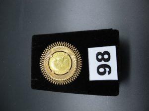 1 broche/pendentif en or serti-griffes d'une piece NAP III de 20 fr (1854).PB 12,1g