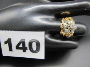 1 bague en or style art déco, ornée d'unmotif bicolore et pierres blanches (TD 54). PB 6,1g