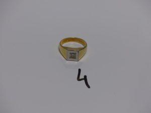 1 chevalière en or et platine ornée d'un diamant Tl brillant d'environ 0,20ct (td60). PB 9,8g