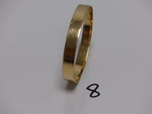 1 bracelet rigide en or, fermoir à décor d'une boucle de ceinture (diamètre 5/6cm). PB 22,3g