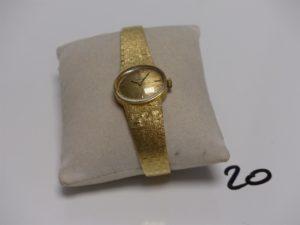 1 Montre dame en or de marque TISSOT (remontoir métal, L17 à 18cm). PB 40g