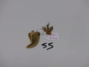 1 pendentif griffe monture en or 4g et 1 pendentif à décor d'un aigle en alliage 14K 3,2g. Le tout 7,2g