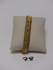 1 bracelet gourmette en or à décor floral (L19,5cm). PB 18,1g