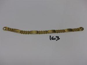 1 bracelet maille articulée en or fermoir orné d'une pierre bleue cabochon (L19cm). PB 22,9g