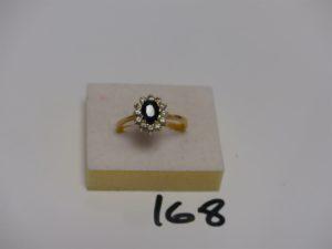 1 bague en or ornée de pierres (td65). PB 4,8g