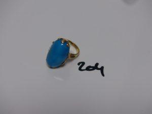 1 bague en or rehaussée d'une pierre couleur turquoise (td55). PB 14,8g