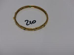 1 bracelet rigide ouvrant en or orné de petites pierres vertes et blanches (diamètre 6cm). PB 8,9g