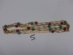 1 sautoir à motifs filigranés en or rehaussé de perles (L182cm). PB 54,5g