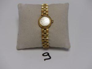 1 montre Dame tout or de marque MOVADO (L16cm, Hors service). PB 28grs