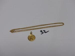 1 chaîne maille gourmette en or (L50cm) et 1 médaille religieuse en or (décor recto/verso). PB 5,1grs