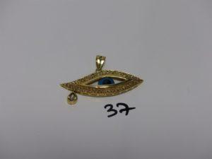 1 pendentif en or à décor d'1 oeil bleu monture ornée de petites pierres (L6cm). PB 10,2grs