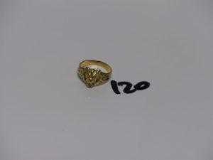 1 bague en or à tête de lion machoir ornée d'1 pierre (Td51). PB 5,1grs