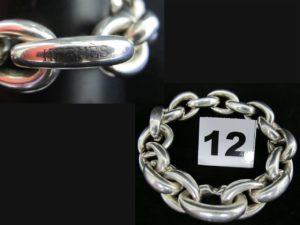 1 bracelet Hermes en argent maille forçat en forme de goutte ouverte (L 23 cm). PB 171g
