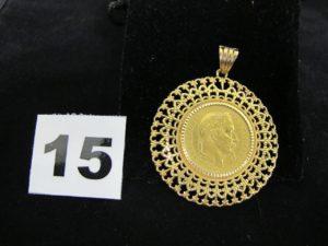 1 pendentif en or serti-griffes d'une pièce de 20Fr, Napoleon III année 1863 (attache limée). PB 11,5g
