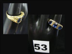 1 bague en or à monture ciselée, ornée de pierres (limées, TD 51). PB 4,5g