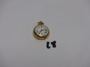 1 montre de sautoir boîtier or dos à décor d'1 étoile ornée de petits diamants (diamètre 2cm, en état de marche). PB 11,8g