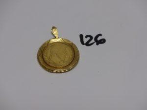 1 pendentif en or serti-griffes un motif ouvragé (style pièce de 50frs). PB 20,8g