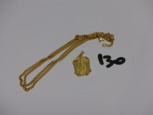 1 chaîne maille gourmette en or (L68cm) et 1 pendentif en or signe astrologique du poisson (gravée au verso). PB 9,8g