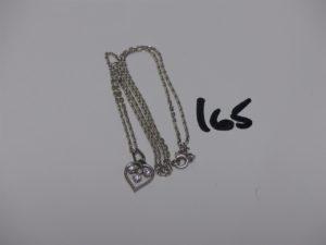 1 chaîne maille forçat (L50cm) et 1 petit pendentif coeur orné de 3 diamants. Le tout en or PB 6,3g