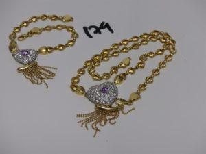 1 collier et 1 bracelet maille articulée en or, motif central à décor d'un coeur orné de pierres et de petites boules en pampille (L43 et 20cm). PB 34,6g