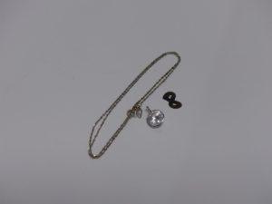 1 chaîne maille torsadée et 1 pendentif orné d'une pierre blanche. Le tout en or PB 3,1g