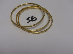3 Bracelets rigides ouvragés en or (diamètre 6,5cm). PB 25,5g