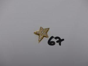 1 pendentif en forme d'étoile en or et orné d'un pavage de diamants. PB 5,6g