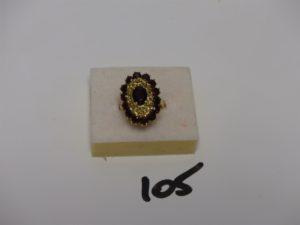 1 bague en or rehaussée de pierres grenats (Td53). PB 7,7g