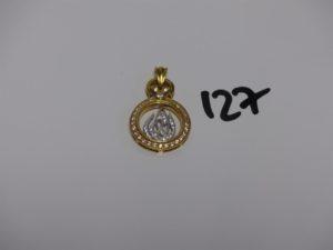 1 pendentif bicolore en or orné de pierres motif central mobile (H3,5cm). PB 8,5g