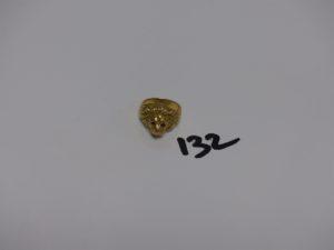 1 bague en or à décor d'1 lion dont les yeux sont ornés d'1 pierre rouge et la machoire d'1 petit diamant (Td53). PB 11,5g