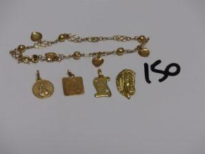1 bracelet cassé, 1 médaille, 3 pendentifs (1 gravé, 1 carré, 1 tête du Christ). Le tout en or. PB 7,2g