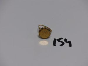 1 bague en or sertie d'1 pièce de 2 pesos (Td54). PB 4,1g